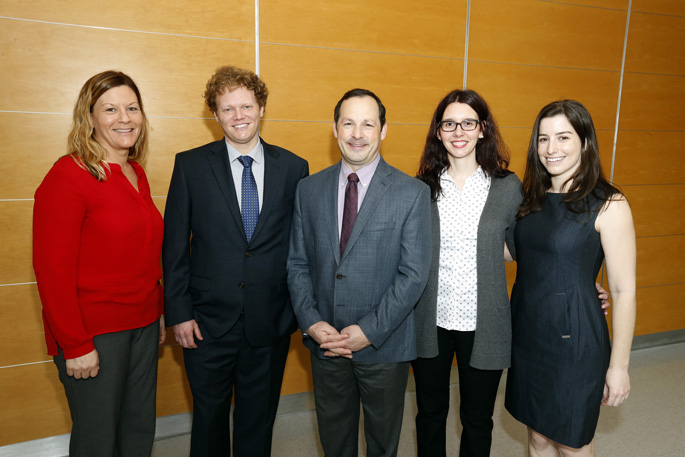 David Calkins, PhD, center, with members of his research team, from left, Wendi Lambert, PhD, Michael Risner, PhD, Melissa Cooper and Silvia Pasini, PhD. (photo by Steve Green)